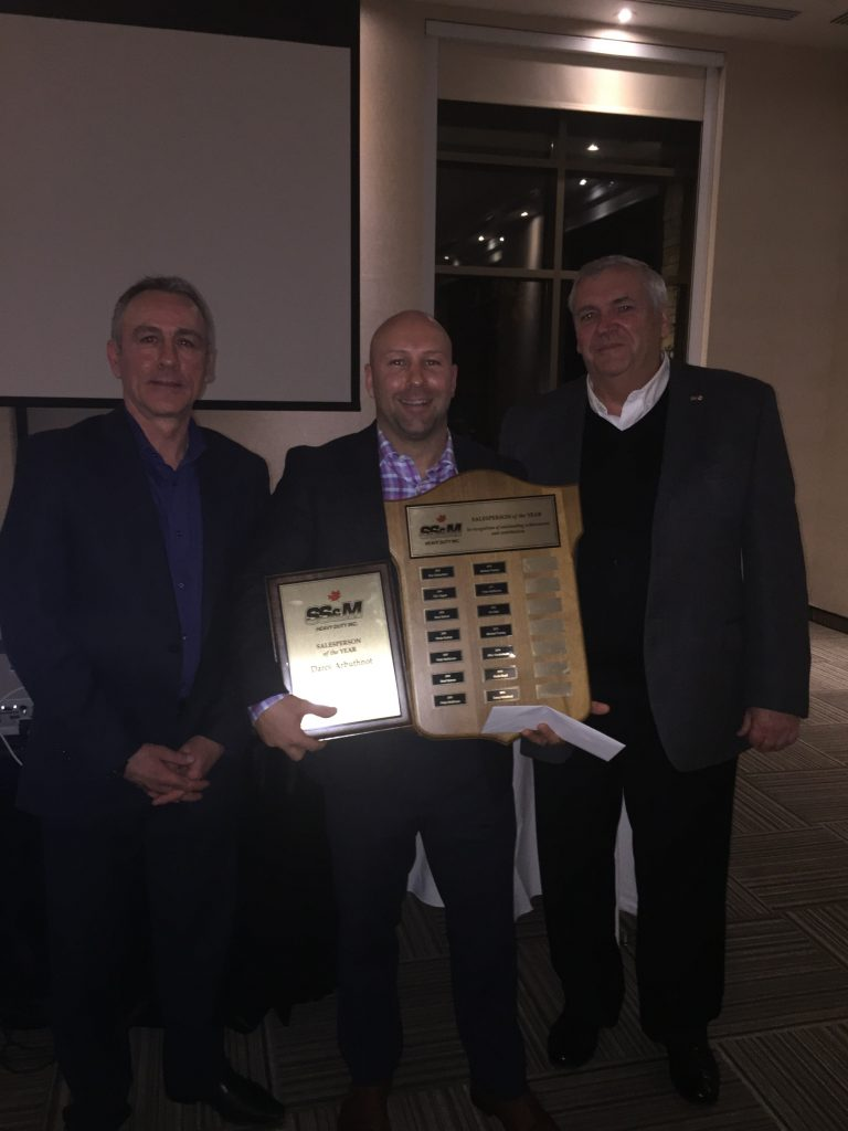 Darcy Arbuthnot accepting his award for 2016 Heavy Duty Salesperson of the Year